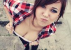 Naughty teen exposes her cute cleavage