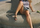 Curly brunette flashing pussy in public