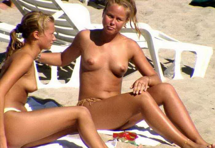 Beautiful babes topless on the sunny beaches