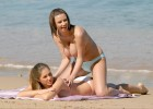 Busty hotties having fun on the beach