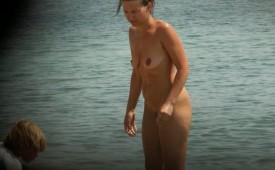 191-Nude-milf-on-the-beach-exposed.jpg