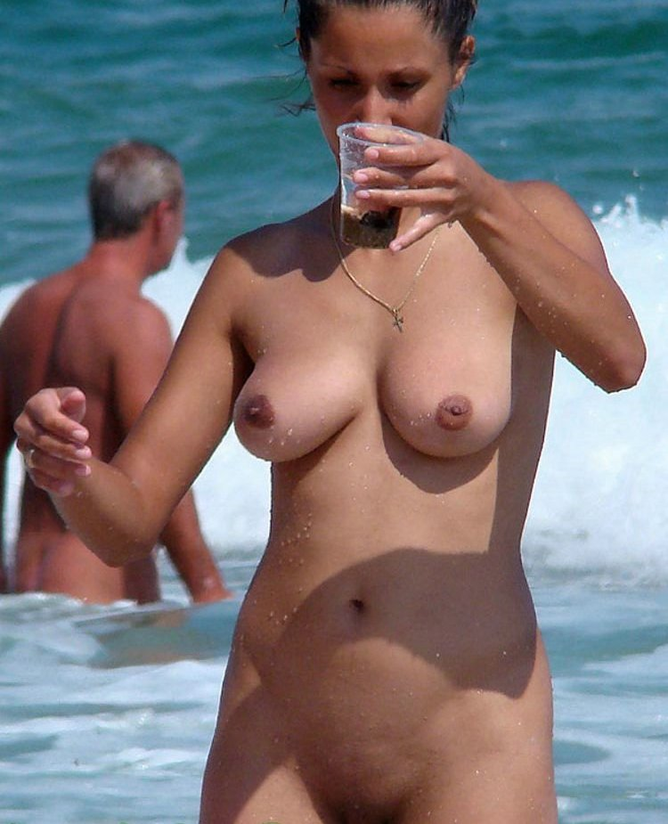 Nude wife looking to the glass