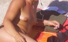 214-Nude-lady-posed-on-the-beach-while-smoking.jpg