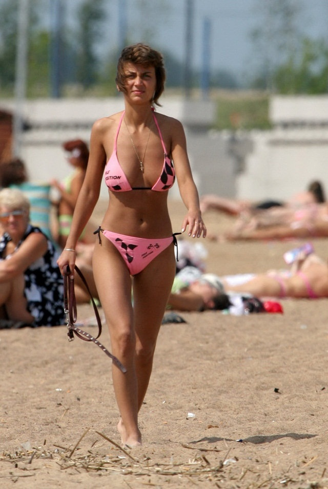 Pink bikinis babe walking through the hot sand