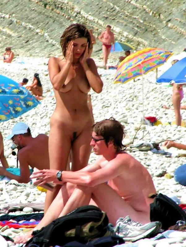 Nudist couple preparing for tanning