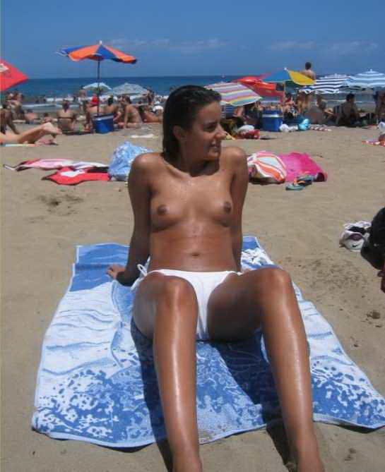 Sunny day on the beach and nice tits