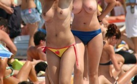 312-Topless-babes-out-for-a-stroll-on-the-beach.jpg