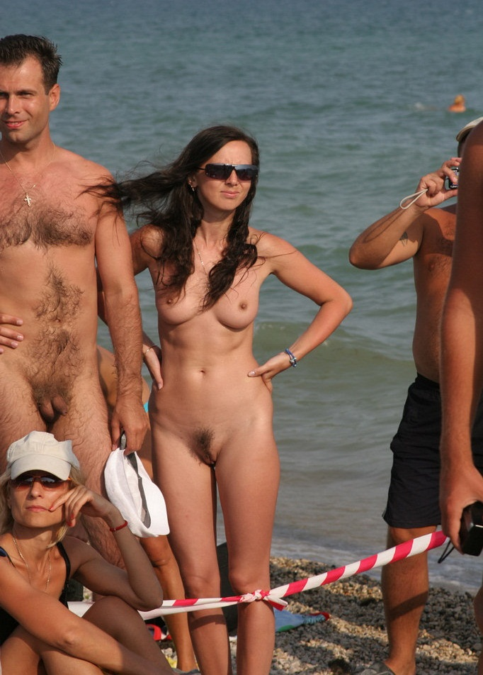 Nudists on the beach posing for pervs
