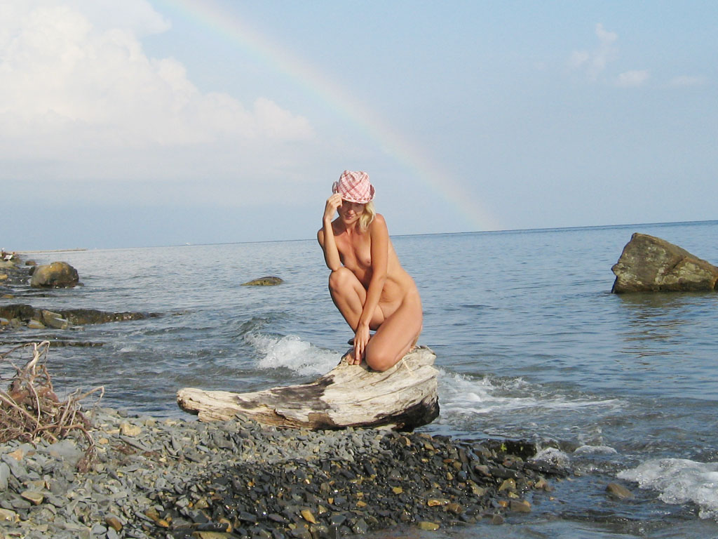 Nude on the rocks ready for photo