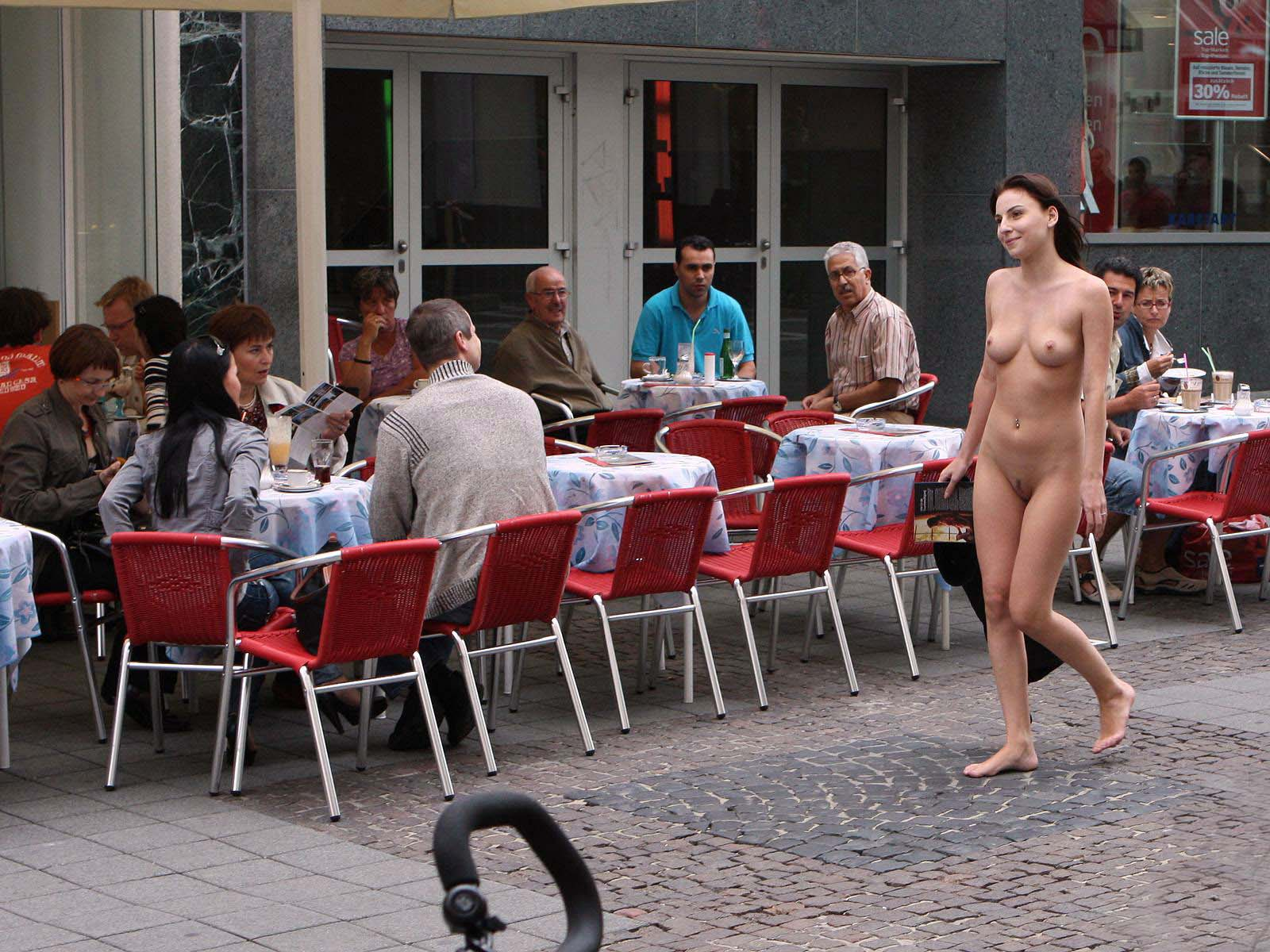 Nude woman walking in street
