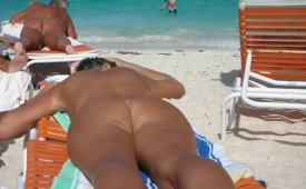 676-Mature-mama-tanning-her-ass-on-the-beach.jpg