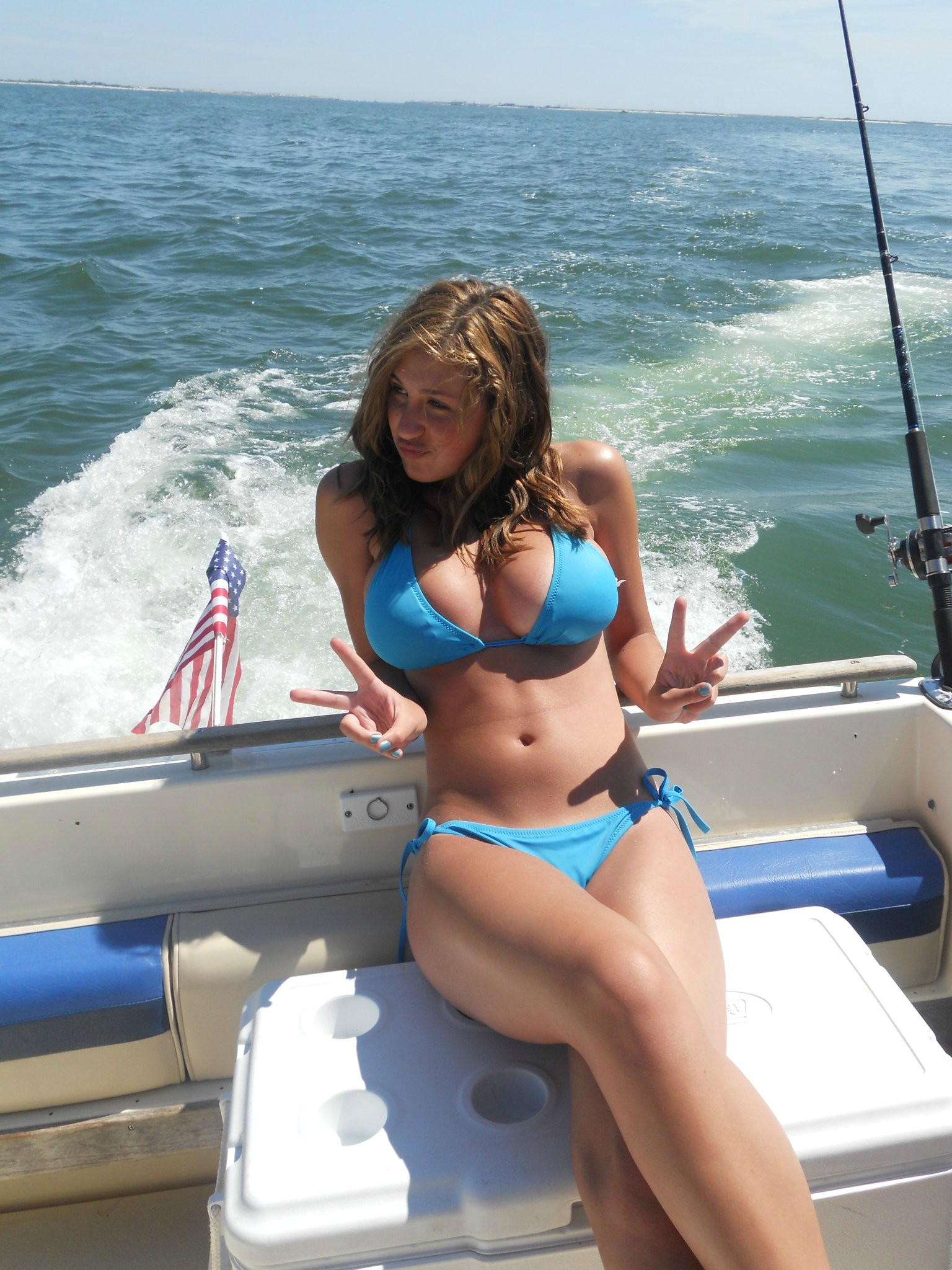 Hottie with a body laid back on the boat