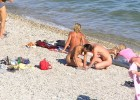 Naked couple on a nudist beach