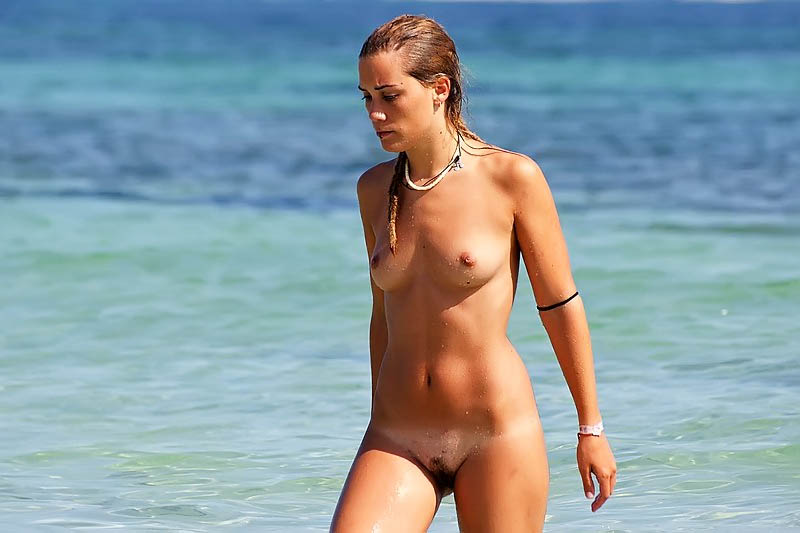 Wet hot babe walking to the shore