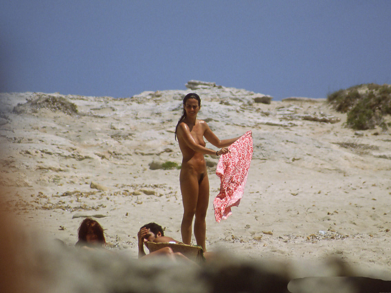 Nude on the beach and my cam caught her