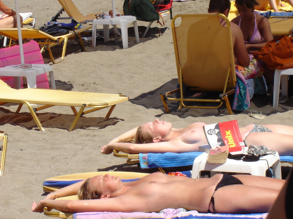 Sweet topless girls catching the sun