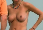 Topless hot babe exposing her boobs and perky nips