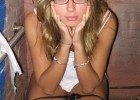 Amateur blond posing with glasses on