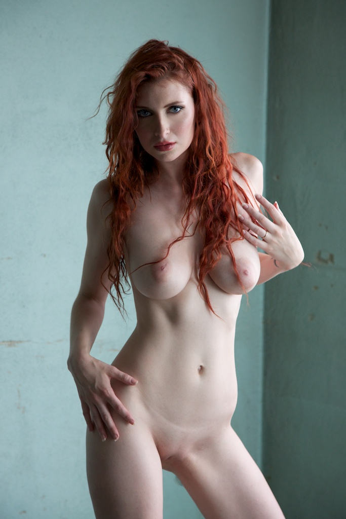 Redhead babe with pale skin posing nude