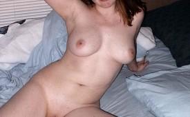 18415-Smiling-while-posing-naked-for-her-man.jpg