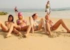 Smokin hot friends in teeny string bikinis spreading their legs