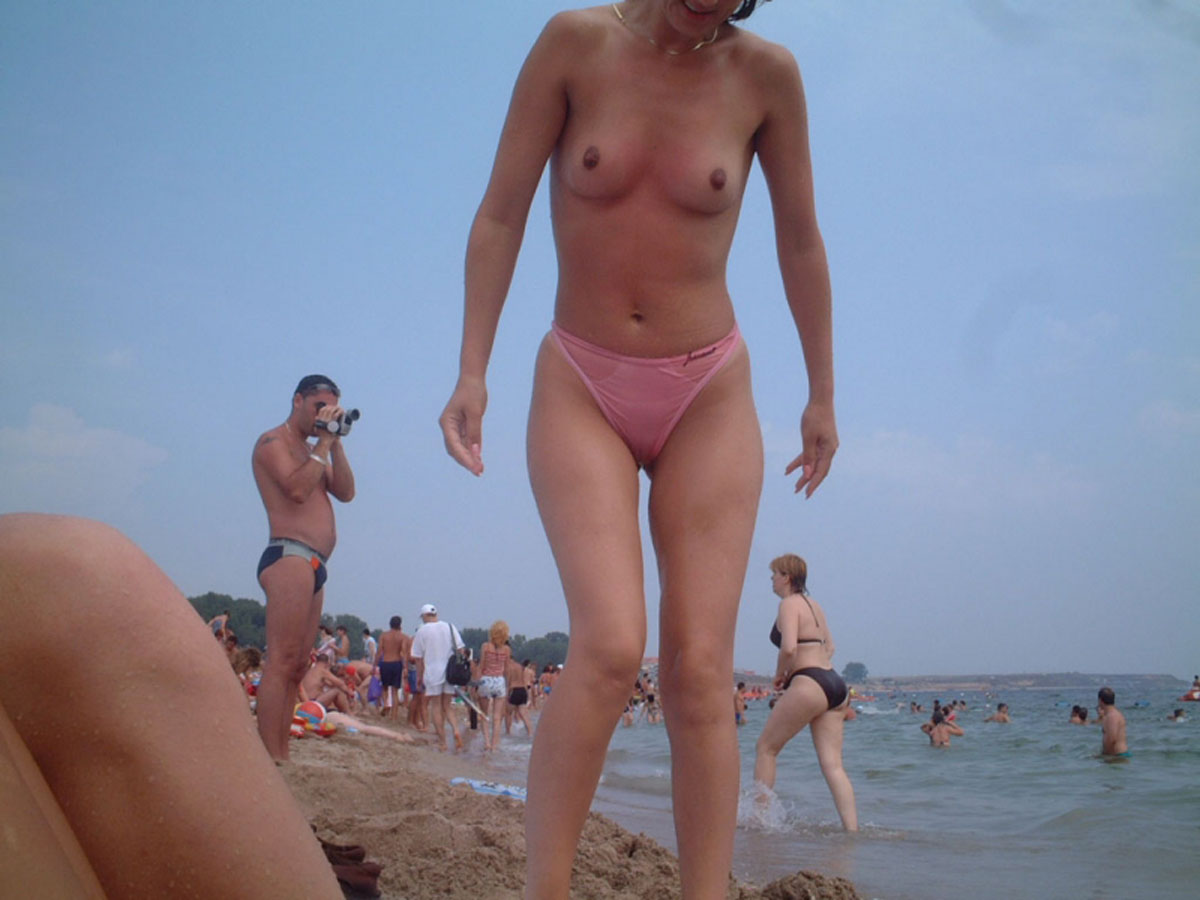 Topless babe at the beach in pink panties