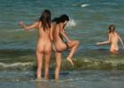 Naked women enjoying the waves