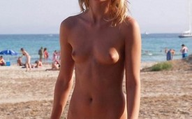 542-Nudist-girl-showing-her-shaved-appetizing-muff.jpg