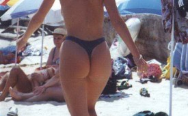 558-Walking-on-the-warm-sands-exposing-her-round-ass.jpg