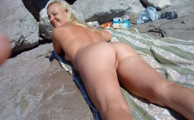 597-Happy-sweet-girl-laying-nude-and-showing-us-her-pussy.jpg