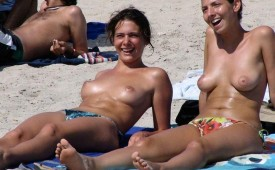 710-Hot-topless-chicks-sharing-a-joke-at-the-beach.jpg