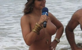 723-Nude-babe-playing-as-reporter-at-the-beach.jpg