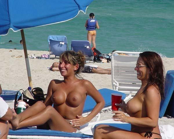 Topless babes getting their boobs ready
