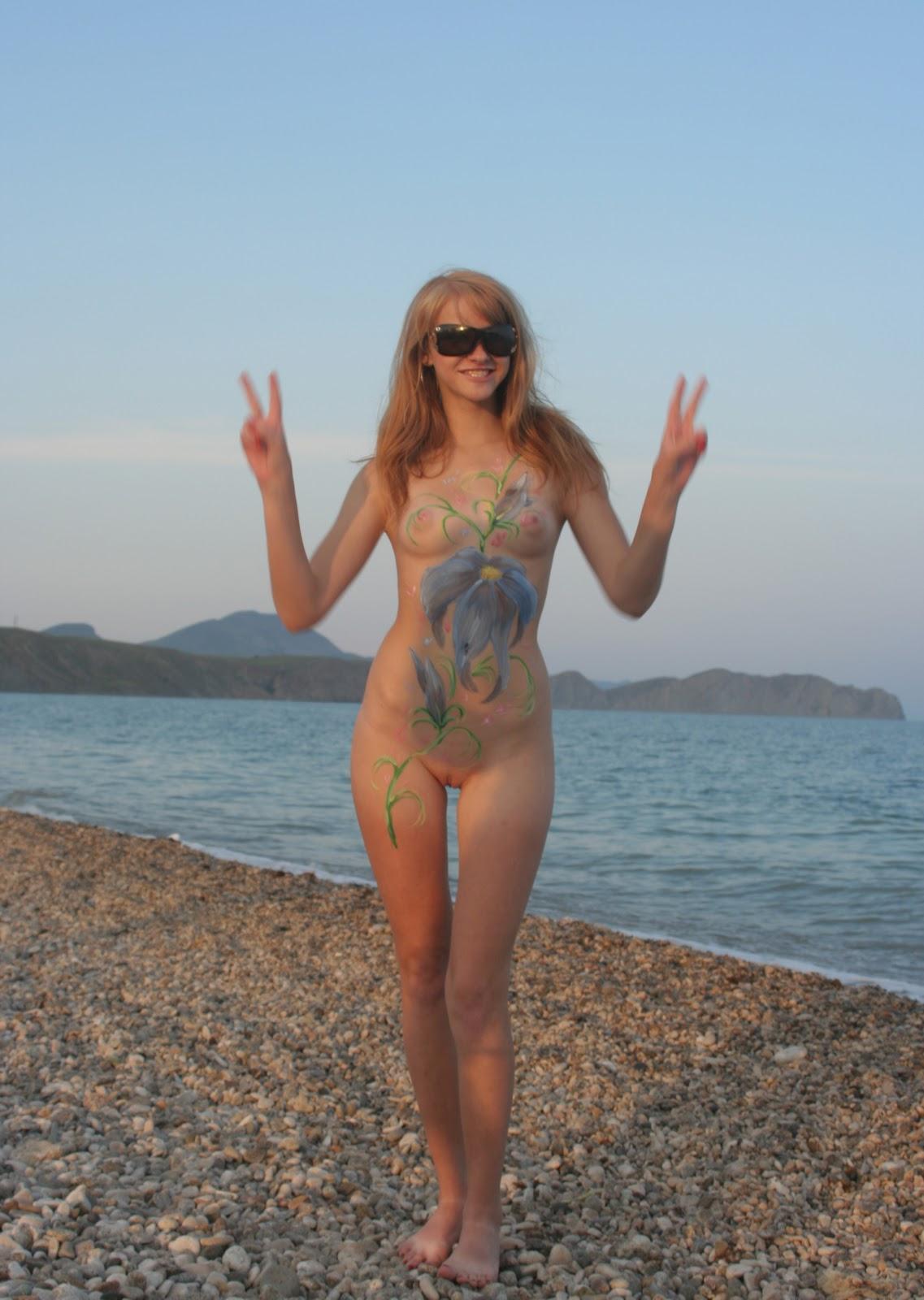 Tattooed hippie chick showing off her body art