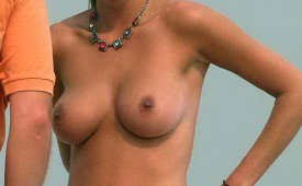 956-Topless-hot-babe-exposing-her-boobs-and-perky-nips.jpg